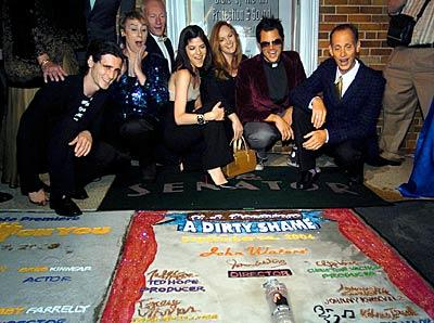 """Cast members and John Waters check out """"Dirty Shame"""" memorial in the sidewalk in front of The Senator Theatre on York Road."""