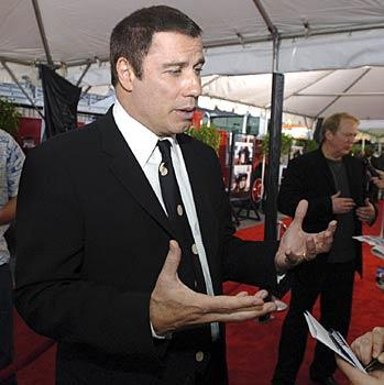 "Actor John Travolta attends the premiere of ""Ladder 49"" at the Senator Theatre."