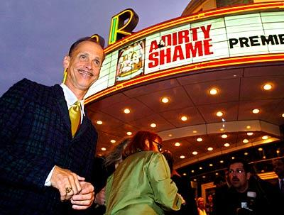 "John Waters smiles a greeting to the crowd outside The Senator Theatre last night where the premiere of ""A Dirty Shame,"" was held."
