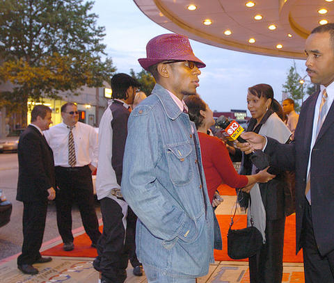 "Actor and musician Mos Def is interviewed as he arrives at the Senator Theatre for a premiere of ""Something the Lord Made."""