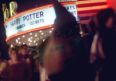 "Fans gather outside the Senator Theatre before the midnight premiere of ""Harry Potter and the Chamber of Secrets."""