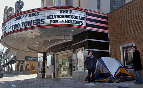 "Fans wait in line outside the historic Senator Theatre for the a showing of the entire ""Lord of the Rings"" trilogy."