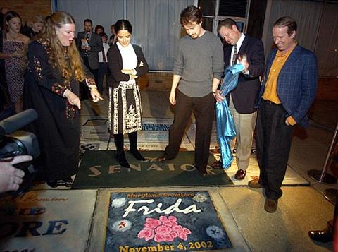 "Rebecca Hoffberger, Salma Hayek, Edward Norton, Senator owner Tom Kiefaber and Tom Rouse unveil the sidewalk square for ""Frida"" outside of the theater."