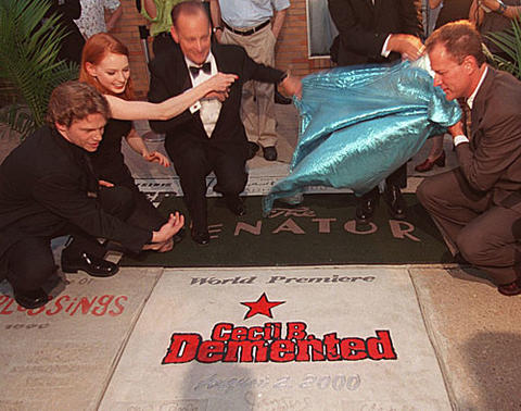 "Jack Noseworthy, Alicia Witt, John Waters and Tom Kiefaber unveil the new sidewalk panel at the Senator Theatre for Waters' ""Cecil B. Demented."""