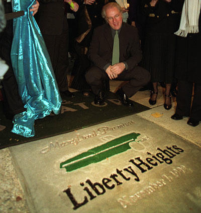 "Director Barry Levinson looks at the sidewalk commemorating his film ""Liberty Heights"" during the premiere at the Senator Theatre."