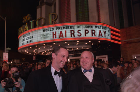 "Baltimore's last surviving movie palace opened in 1939 and is still showing movies. A $3.5 million renovation completed in October 2013, just in time for its 75th anniversary, restored the building's art-deco splendor.  (Pictured: Baltimore filmmaker John Waters and Harris Glenn Milstead - aka Divine - at the 1988 premiere of ""Hairspray"" at the Senator Theatre.)"