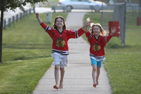 Emily and Katie whoop it up for the Blackhawks