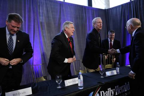 The four Republican candidates for governor, state Sen. Bill Brady, left, state Sen. Kirk Dillard, second left, businessman Bruce Rauner, second right, and Illinois Treasurer Dan Rutherford, right, leave the stage after participating in a candidates forum.