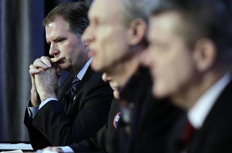 State Sen. Bill Brady, left, listens during a forum for the Republican candidates for governor.