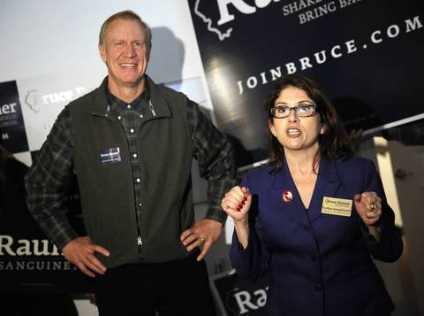 Republican gubernatorial candidate Bruce Rauner and running mate Evelyn Sanguinetti visit their campaign headquarters in Chicago.