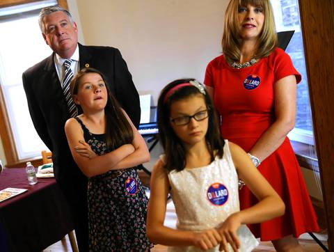 State Sen. Kirk Dillard with his wife, Stephanie, and daughters, Ava, 9, left, and Emma, 12, in his boyhood home near Wrigley Field after he announced his run for Illinois governor.