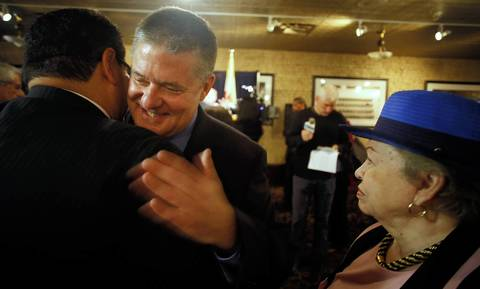 State Treasurer Dan Rutherford hugs a supporter after he announced his candidacy for governor.