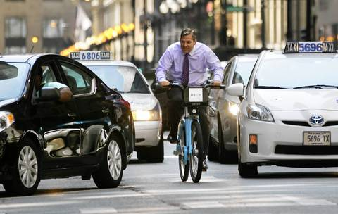 "Attorney Bill Choslovsky, who initially thought the Divvy program would fail, has used the ""Chicago blue"" bikes a few times and has enjoyed the experience."