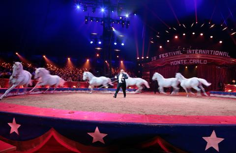 Vinicio Canestrelli Togni performs with horses during the Award Gala evening of the 38th International Circus Festival of Monte Carlo in Monaco on January 21, 2014.