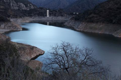 The low water level of Morris Reservoir is seen before dawn on the San Gabriel River in the Angeles National Forest on January 22, 2014 in near Azusa, California. Now in its third straight year of drought conditions, California is experiencing its driest year on record, dating back 119 years, and reservoirs throughout the state have low water levels. Unseasonable dangerous wildfire weather helped spread the nearby 1,952-acre Colby Fire which firefighters are about to contain but not before it destroyed five homes, damaged 17 others and injured six people. Gov. Jerry Brown officially declared a drought emergency on Friday to speed up assistance to local governments, streamline water transfers and potentially ease environmental protection requirements for dam releases.