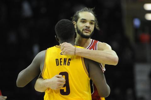 Joakim Noah hugs the Cavaliers' Luol Deng after the Bulls won 98-87.