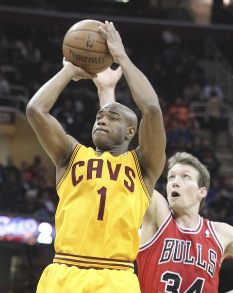 The Cavaliers' Jarret Jack puts up a first-quarter shot as Mike Dunleavy defends.