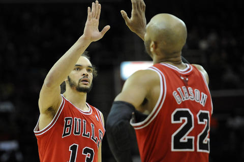 Joakim Noah and Taj Gibson celebrate in the third quarter against the Cavaliers.