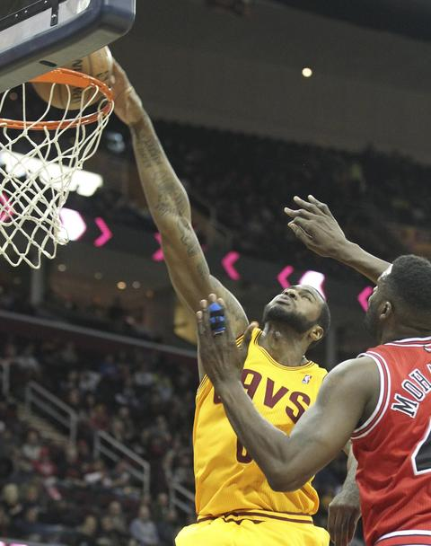 The Cavaliers' Earl Clark dunks on Nazr Mohammed during the second quarter.