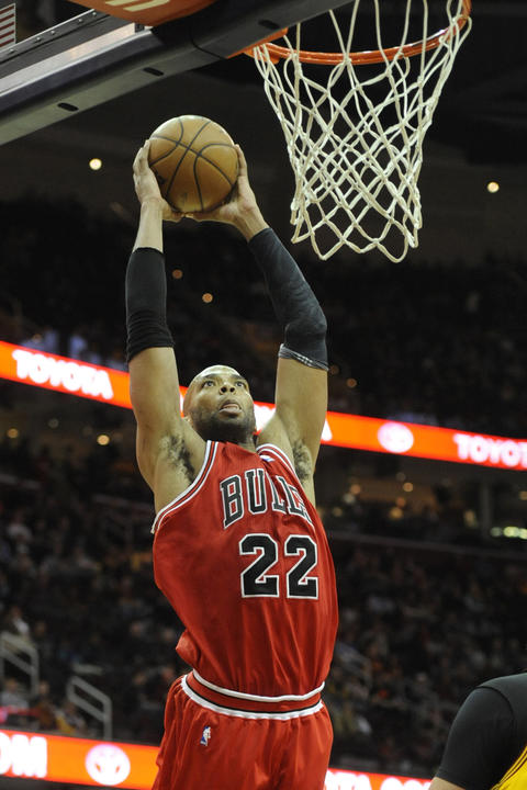 Taj Gibson dunks against the Cavaliers in the first quarter.
