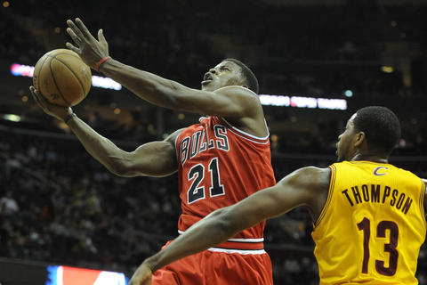 Jimmy Butler drives against the Cavaliers' Tristan Thompson in the first quarter.