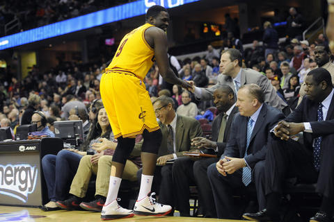 Luol Deng shakes hands with coaches on the Bulls bench prior to the game.