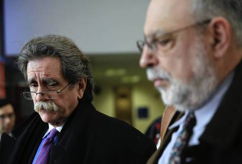 Attorneys Michael Durkin, left, and Michael Deutsch speak to the media after a hearing for their clients.
