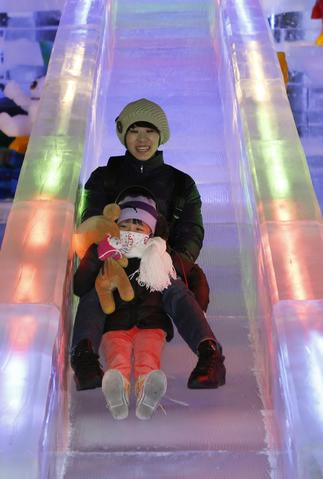 "People play on the ice slide at ""Fantasy Ice World"" on January 23, 2014 in Taipei, Taiwan."