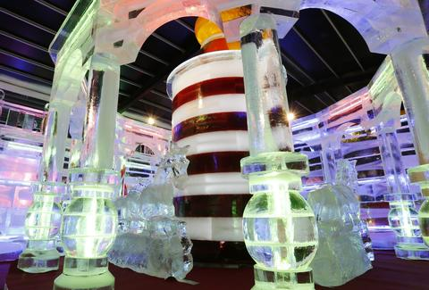 "Merry-go-round ice sculpture is displayed at ""Fantasy Ice World"" on January 23, 2014 in Taipei, Taiwan."