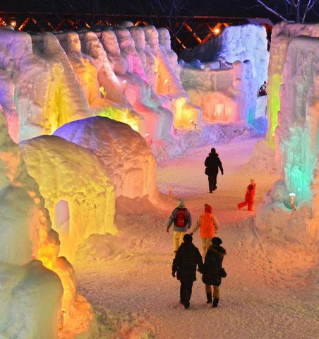 People visit the Chitose-Lake Shikotsu Ice Festival illuminated by colorful light to produce a fantastic world in Chitose on January 24, 2014.
