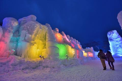 Couple visit the Chitose-Lake Shikotsu Ice Festival illuminated by colorful light to produce a fantastic world in Chitose, Hikkaido prefecture on January 24, 2014.