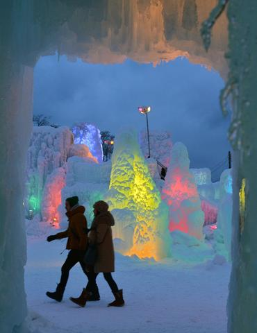 Couple visit the Chitose-Lake Shikotsu Ice Festival illuminated by colorful light to produce a fantastic world in Chitose on January 24, 2014.