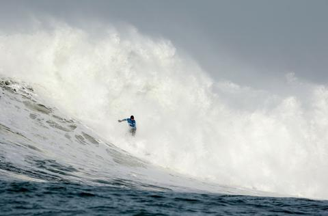 Peter Mel rides a wave during the second heat of round one of Mavericks Invitational on January 24, 2014 in Half Moon Bay, California.