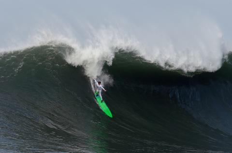 Nic Lamb rides a wave during the third heat of round one of Mavericks Invitational on January 24, 2014 in Half Moon Bay, California.