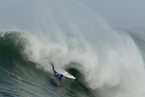 Carlos Burle crashes on a wave during the third heat of round one of Mavericks Invitational on January 24, 2014 in Half Moon Bay, California.