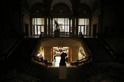 The Michigan Avenue entrance lobby, below, and the collection of European art before 1900, beyond the darkened Grand Staircase as the Art Institute of Chicago shuts down for the night.