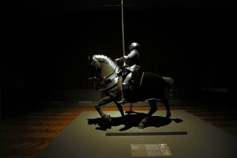 After closing time at the Art Institute of Chicago, a knight and horse's armor in the Maximilian style from the 16th century are lit by a security light in an otherwise darkened collection of arms and armor in gallery 236.