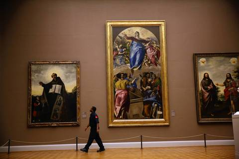 """Evening shift security officer Marcus Riggs, 28, walks his route as part of a nightly inspection of all galleries, passing by """"Assumption of the Virgin,"""" center, by El Greco."""