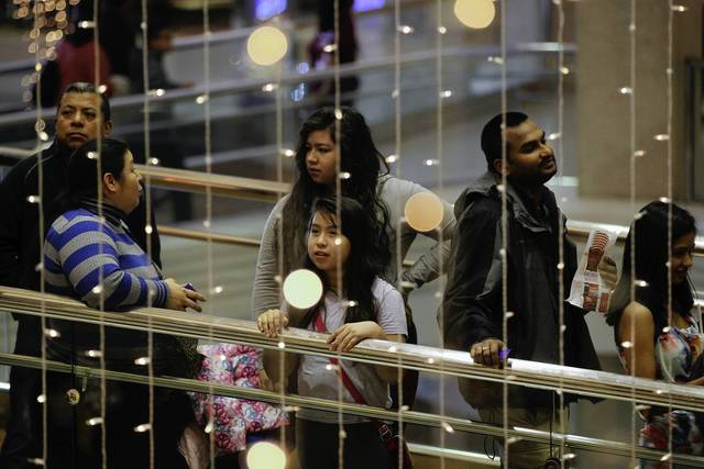 People line up for the opening of H&M at Woodfield Mall in Schaumburg on Thanksgiving in the evening.