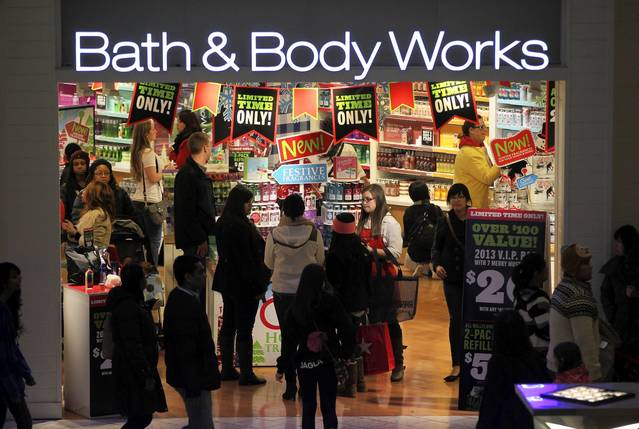 People shop at Bath & Body Works at Woodfield Mall in Schaumburg on Thanksgiving in the evening.