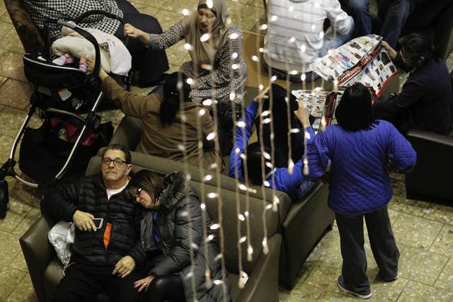 People wait for the opening of stores at Woodfield Mall in Schaumburg on Thanksgiving in the evening.