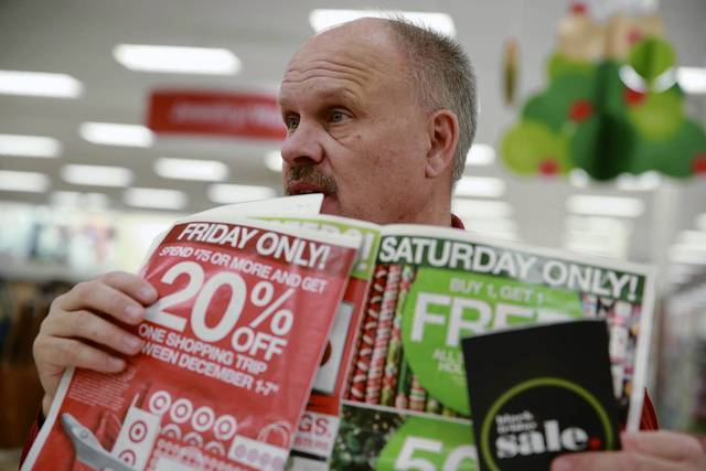 Store manager Lee Crum shows employees advertised sales before opening the Target store on North Elston Avenue at 8 p.m. on Thanksgiving.