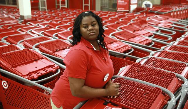 Employee Quanesha Borum, 23, waits amid rows of shopping carts for the Target store on North Elston Avenue to open at 8 p.m. on Thanksgiving.