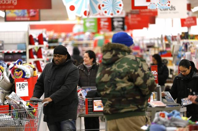 Early morning shoppers walk the aisles of Kmart at 3443 W. Addison Street in Chicago.