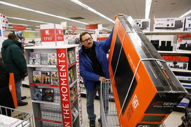 Luis Torres picks up his 50 inch LED television at a Kmart at 3443 W. Addison Street in Chicago on Thursday.