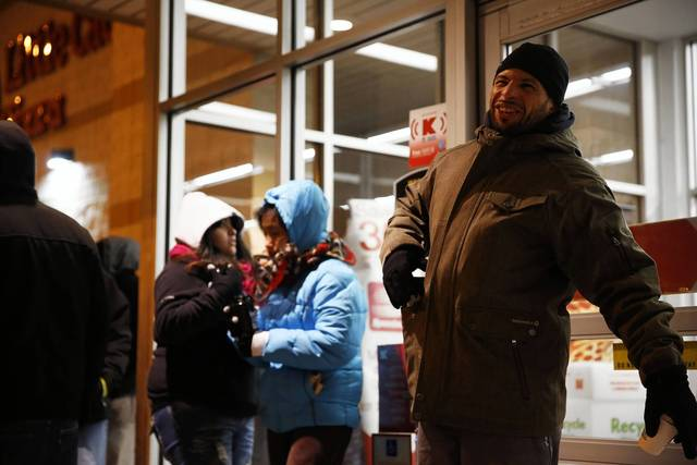 David Correa, 41, is first in line as shoppers line up outside of Kmart at 3443 W. Addison Street in Chicago waiting for the doors to open on Thursday. Correa said that he was in line starting at 1a.m. this morning.