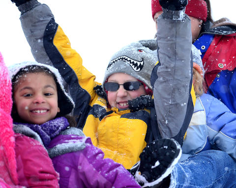 Big fun in the snow on the large hill in Catasauqua Park draws this group of friends to toboggan. From left: Victoria Phillips, 7, of Bethlehem; Caleb Bleiler, 10 of Catasauqua (arms up).