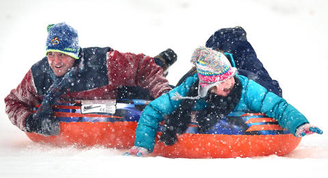 Big fun in the snow on the large hill in Catasauqua Park draws Erik Rockwell of Whitehall and his daughter Kendra Rockwell, 9, of Whitehall.