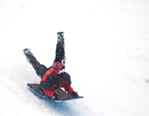 Big fun in the snow on the large hill in Catasauqua Park draws this youngster to slide down the hill Saturday.