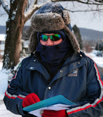 Mail carrier Jim Braun finished his route Saturday on South Race Street in Allentown.